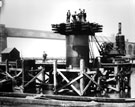 Transporter Bridge: Group of men on tower base