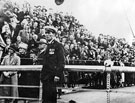 Crowds waiting for the visit of King George V at the transporter bridge with the bridge supervisor.